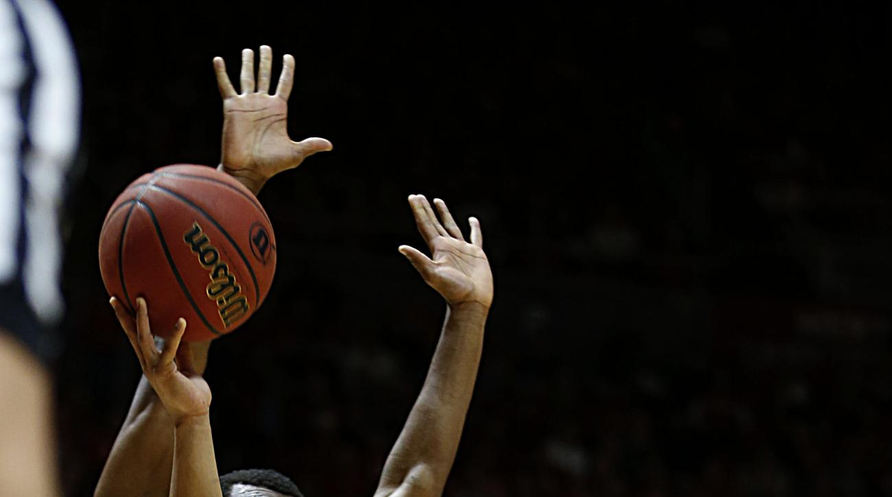 Utah guard Brandon Taylor (11) shoots past Arizona guard Kadeem Allen (5) during the first half of an NCAA college basketball game in Salt Lake City, Saturday, Feb. 27, 2016. (AP Photo/George Frey)
