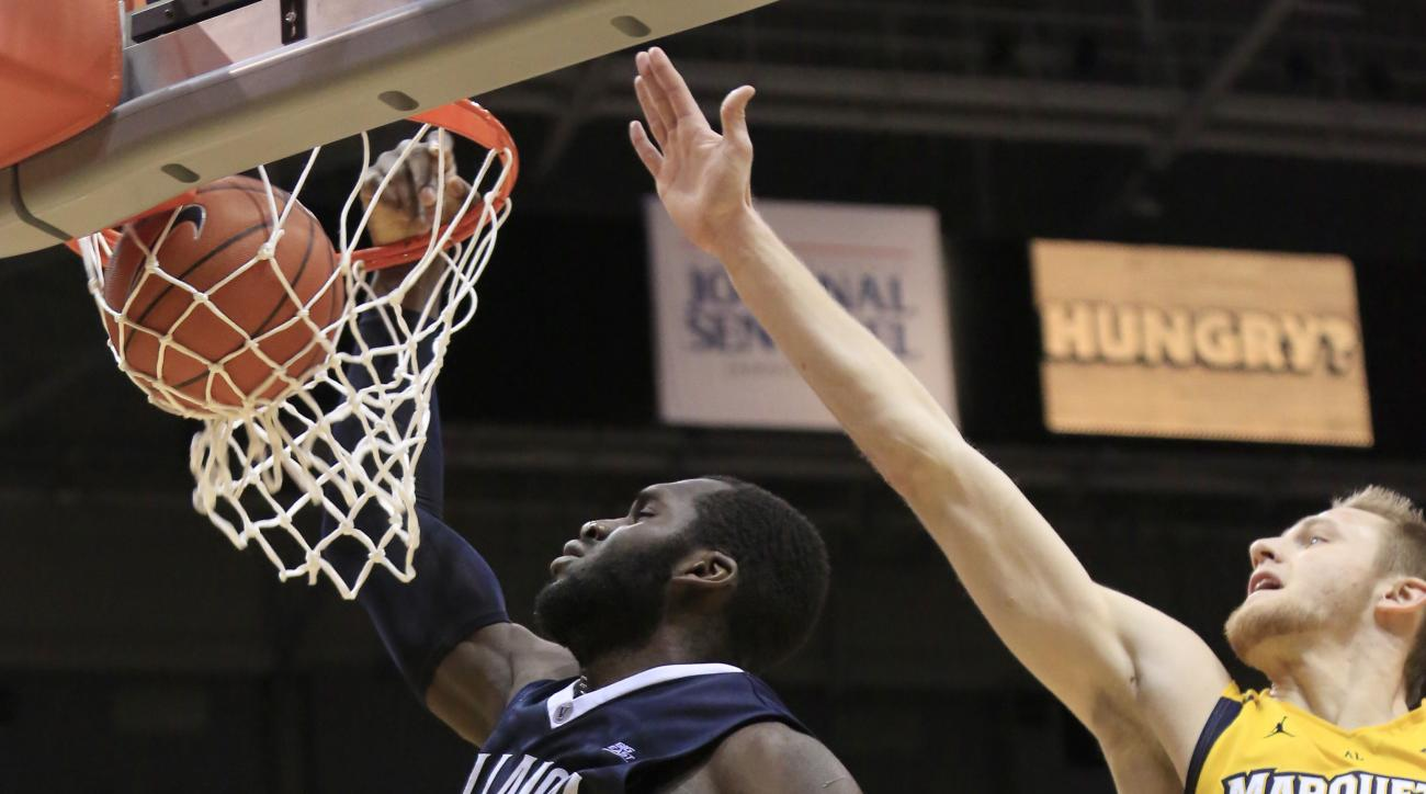 Villanova forward Daniel Ochefu dunks against Marquette during the second half of an NCAA basketball game Saturday, Feb. 27, 2016, in Milwaukee. Villanova defeated Marquette 89-79. (AP Photo/Darren Hauck)