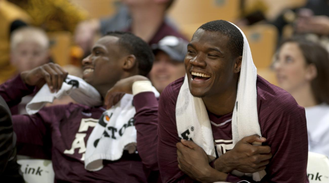 Texas A&M's Jalen Jones, right, laughs while on the bench during the second half of an NCAA college basketball game against Missouri Saturday, Feb. 27, 2016, in Columbia, Mo. Texas A&M won 84-69. (Nick Schnelle/Columbia Daily Tribune via AP)