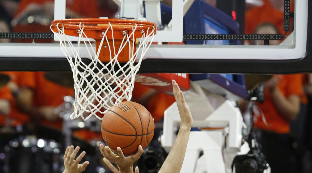 Virginia guard Malcolm Brogdon (15) takes a shot over North Carolina forward Justin Jackson (44) during the first half of an NCAA college basketball game in Charlottesville, Va., Saturday, Feb. 27, 2016. (AP Photo/Steve Helber)