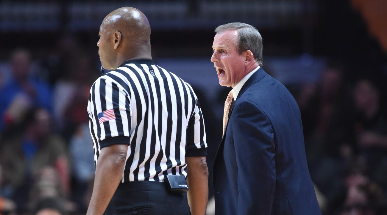 Tennessee coach Rick Barnes talks to a referee on the sideline during the team's NCAA basketball game against Arkansas in Knoxville, Tenn., Saturday, Feb. 27, 2016. Arkansas won 75-65. (Adam Lau/Knoxville News Sentinel via AP)