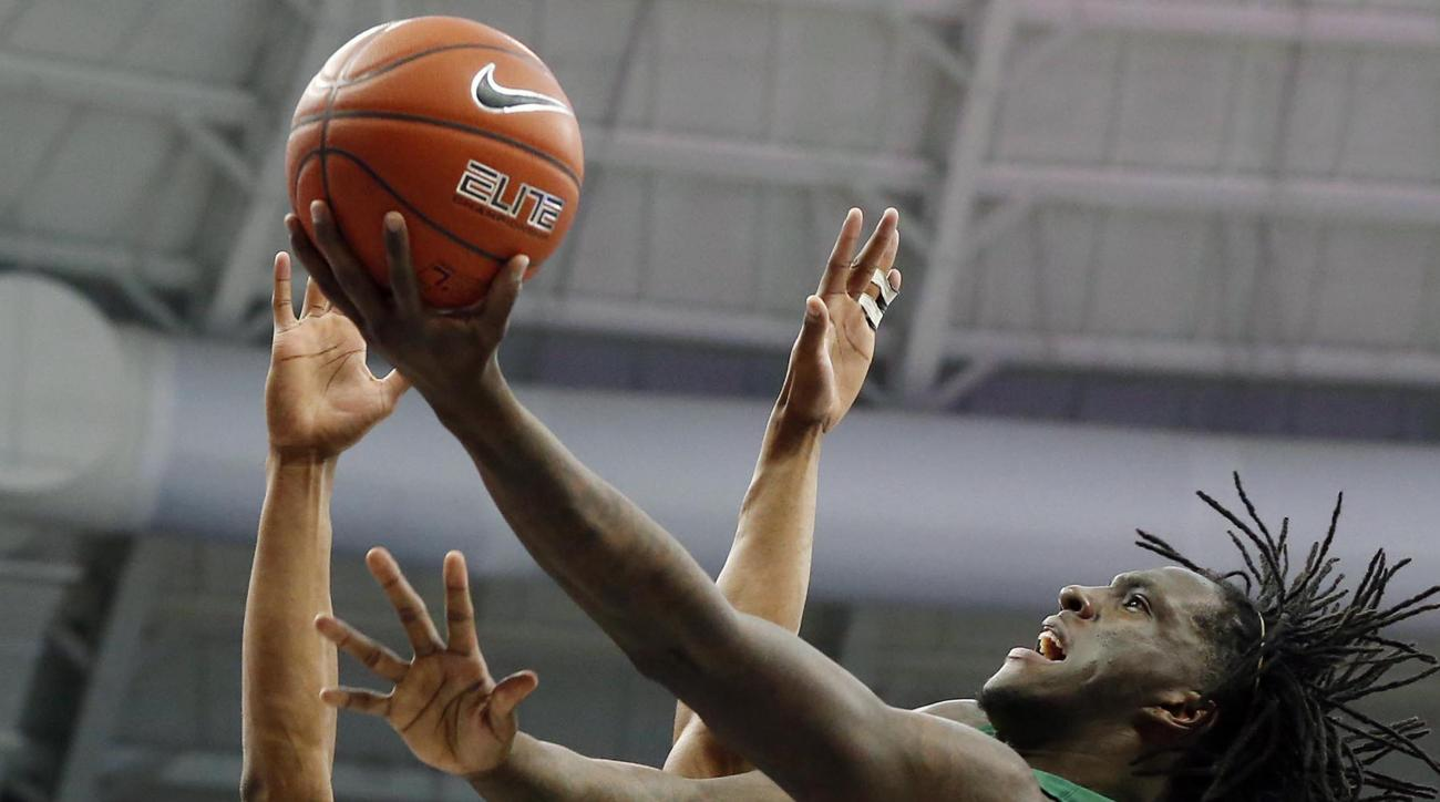 Baylor forward Taurean Prince, right, scores over TCU guard Brandon Parrish during the first half of an NCAA college basketball game Saturday, Feb. 27, 2016, in Fort Worth, Texas. Baylor won 86-71. (Rod Aydelotte/Waco Tribune Herald via AP)