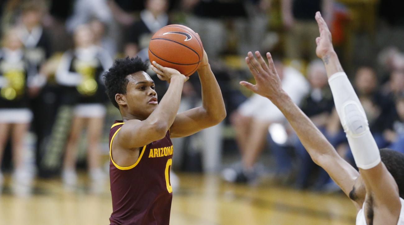 Arizona State guard Tra Holder, left, takes a 3-point shot over Colorado forward Josh Scott in the first half of an NCAA college basketball game Sunday, Feb. 28, 2016, in Boulder, Colo. (AP Photo/David Zalubowski)