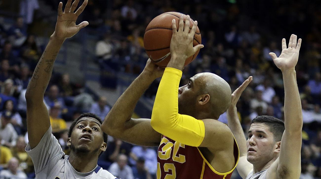 Southern California's Julian Jacobs, center, shoots between California's Tyrone Wallace (3) and Sam Singer, right, in the second half of an NCAA college basketball game Sunday, Feb. 28, 2016, in Berkeley, Calif. (AP Photo/Ben Margot)