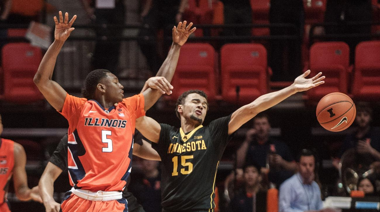 Illinois guard Jalen Coleman-Lands (5) has the ball knocked away by Minnesota guard Stephon Sharp (15) in the second half of an NCAA College basketball game in Champaign, Ill., Sunday, Feb. 28, 2016. Illinois won 84-71. (AP Photo/Rick Danzl)