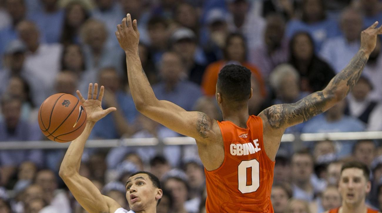 North Carolina's Marcus Paige (5) makes a steal from Syracuse's Michael Gbinije (0) during the first half of an NCAA college basketball game in Chapel Hill, N.C., Monday, Feb. 29, 2016. (Robert Willett/The News & Observer via AP) MANDATORY CREDIT
