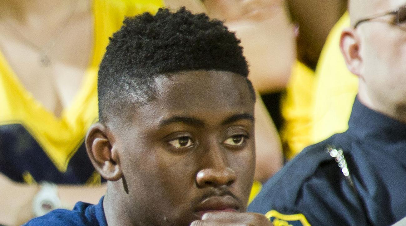 FILE - In this Feb. 6, 2016, file photo, Michigan's Caris LeVert watches from the bench in the second half of an NCAA college basketball game against Michigan State at Crisler Center in Ann Arbor, Mich. LeVert has been ruled out for the rest of the season