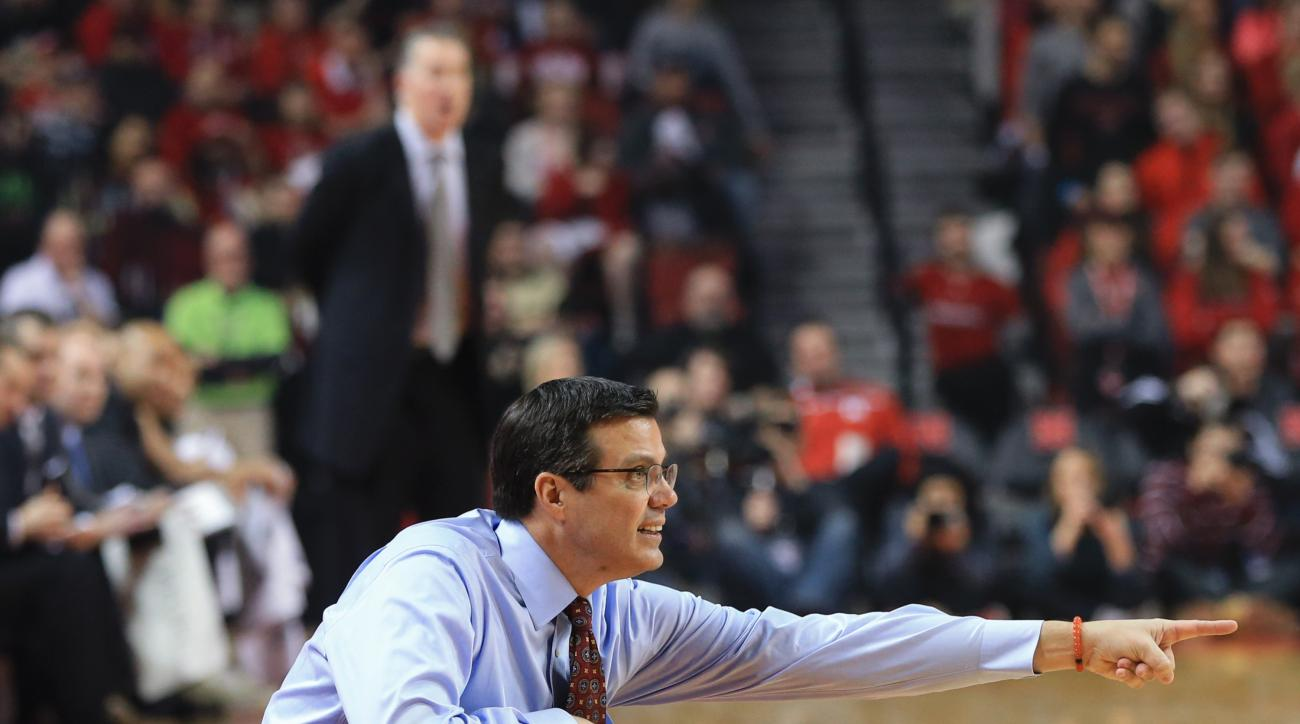 Nebraska coach Tim Miles points, with Purdue coach Matt Painter standing, rear, during the first half of an NCAA college basketball game in Lincoln, Neb., Tuesday, March 1, 2016. (AP Photo/Nati Harnik)
