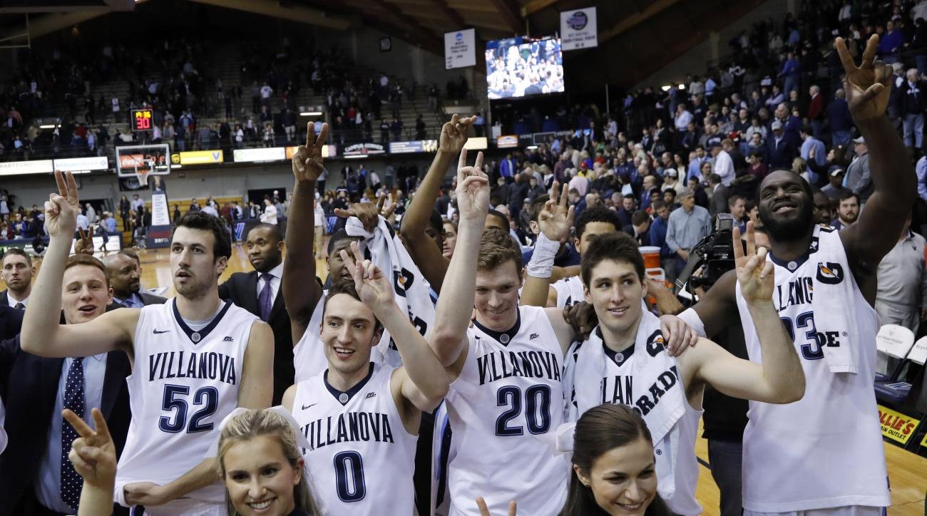 Villanova players and cheerleaders celebrate after winning an NCAA college basketball game against DePaul, 83-62, Tuesday, March 1, 2016, in Philadelphia. (AP Photo/Matt Slocum)