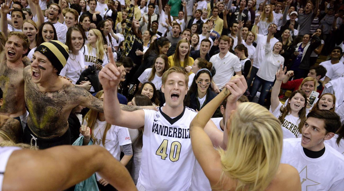 Vanderbilt center Josh Henderson (40) celebrates with fans after defeating Tennessee 86-69 in an NCAA college basketball game Tuesday, March 1, 2016, in Nashville, Tenn. (Andrew Nelles/The Tennessean via AP)
