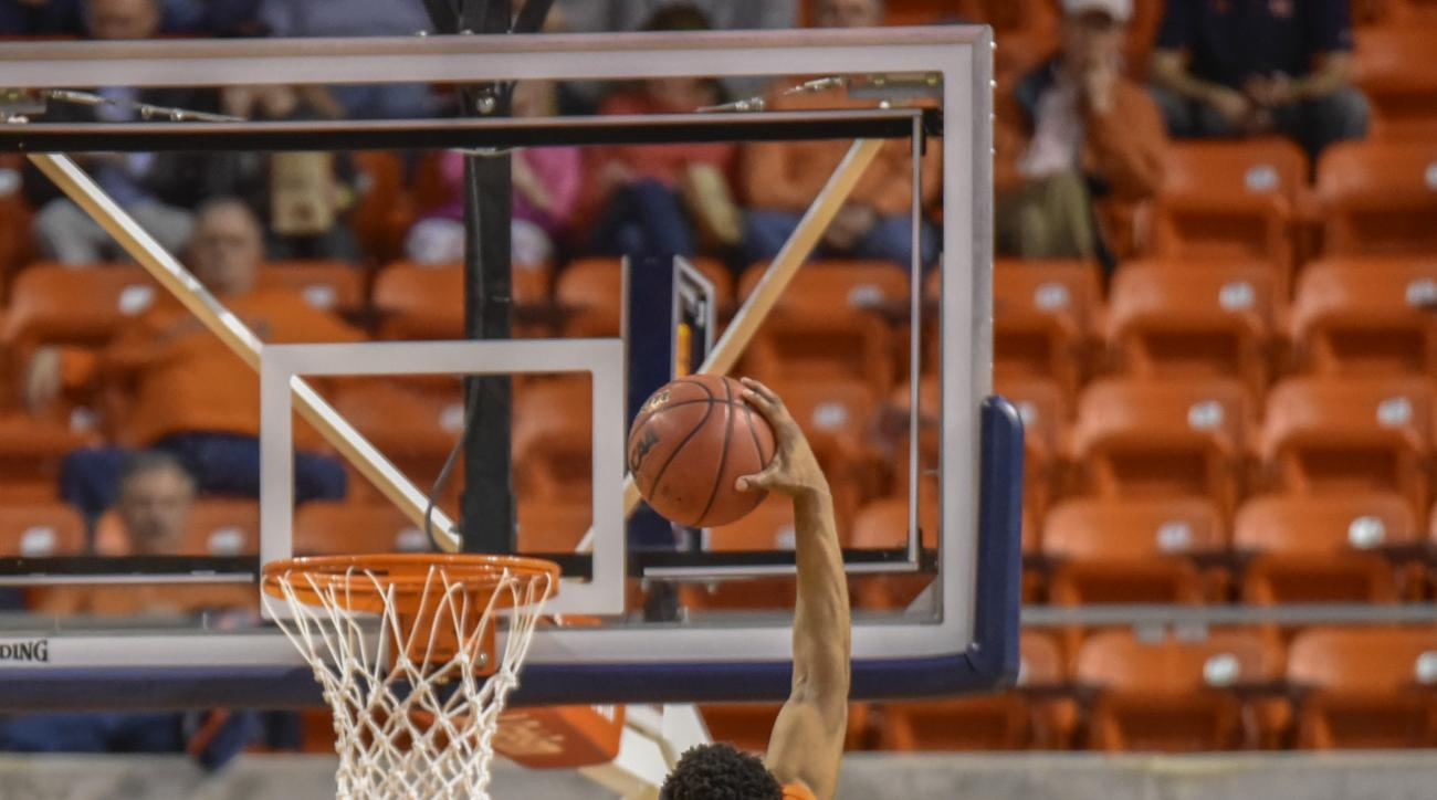 Auburn forward Horace Spencer (0) dunks the ball on Texas A&M guard Jalen Jones (12) during the first half of an NCAA college basketball game, Tuesday March 1, 2016, in Auburn, Ala. (AP Photo/Matthew Bishop)