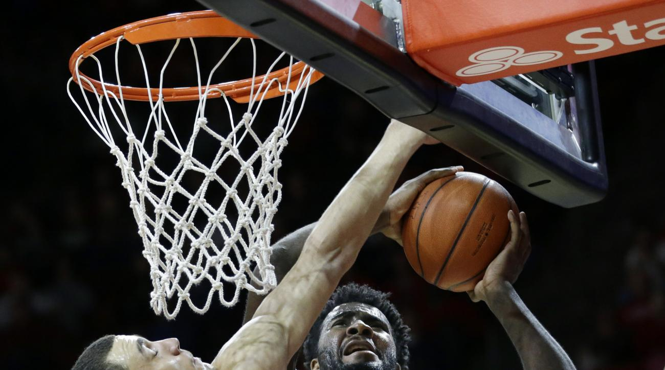 Rutgers forward D.J. Foreman (1) tries to make a basket as Michigan State forward Gavin Schilling (34) tries to block his path during the first half of an NCAA college basketball game Wednesday, March 2, 2016, in Piscataway, N.J. (AP Photo/Mel Evans)