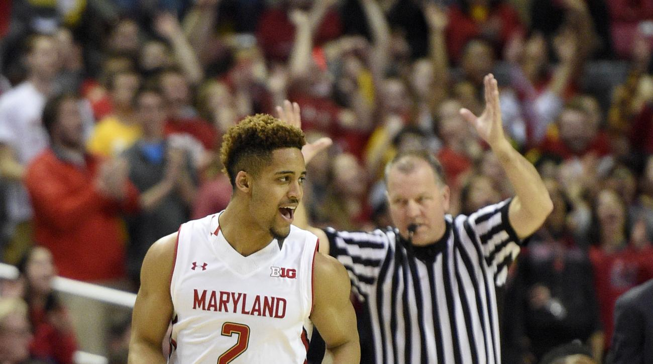 Maryland guard Melo Trimble (2) reacts after a basket during the first half of the team's NCAA college basketball game against Illinois, Thursday, March 3, 2016, in College Park, Md. (AP Photo/Nick Wass)