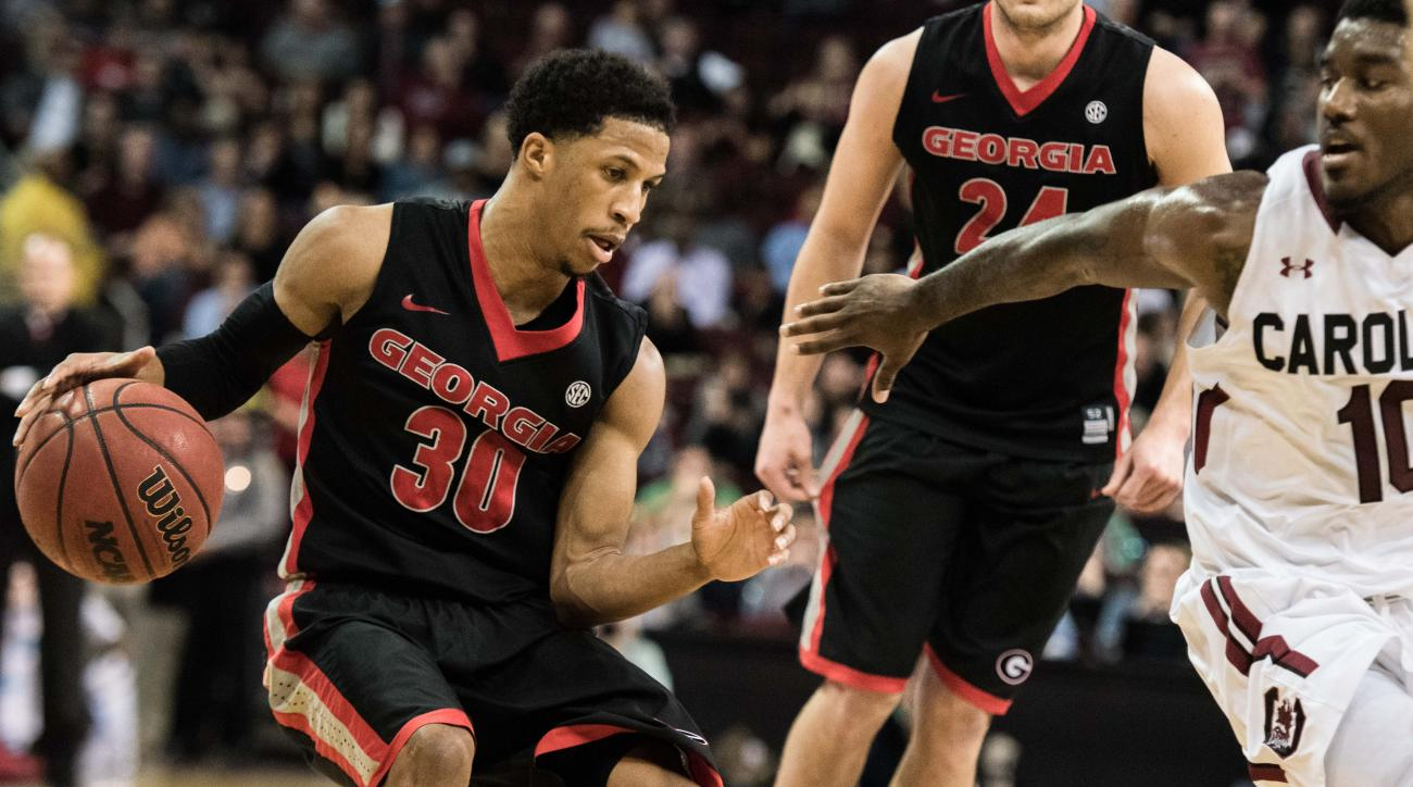 Georgia guard J.J. Frazier (30) drives to the hoop against South Carolina guard Duane Notice (10) during the first half of an NCAA college basketball game Thursday, March 3, 2016, in Columbia, S.C. (AP Photo/Sean Rayford)