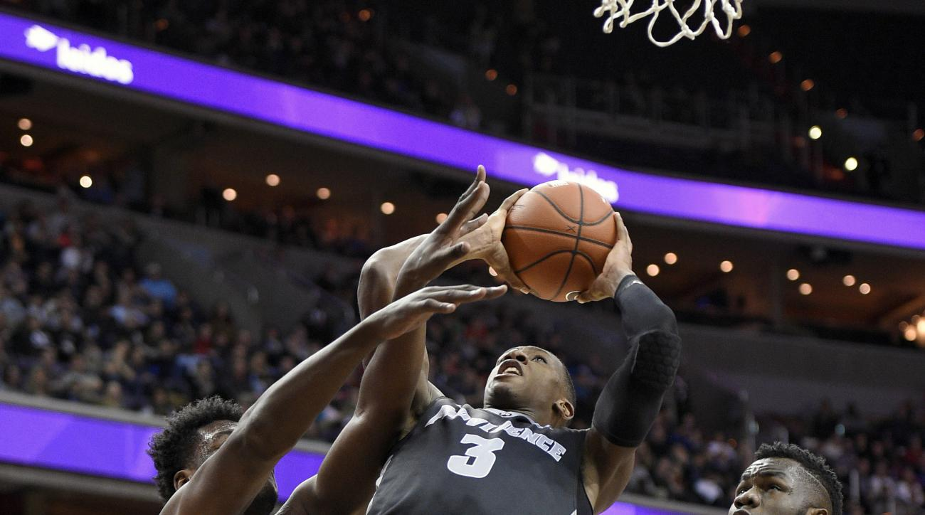 FILE - In this Jan. 30, 2016, file photo, Providence guard Kris Dunn (3) goes to the basket against Georgetown forward Marcus Derrickson, left, and center Jessie Govan (15) during an NCAA college basketball game in Washington. Dunn was the preseason playe