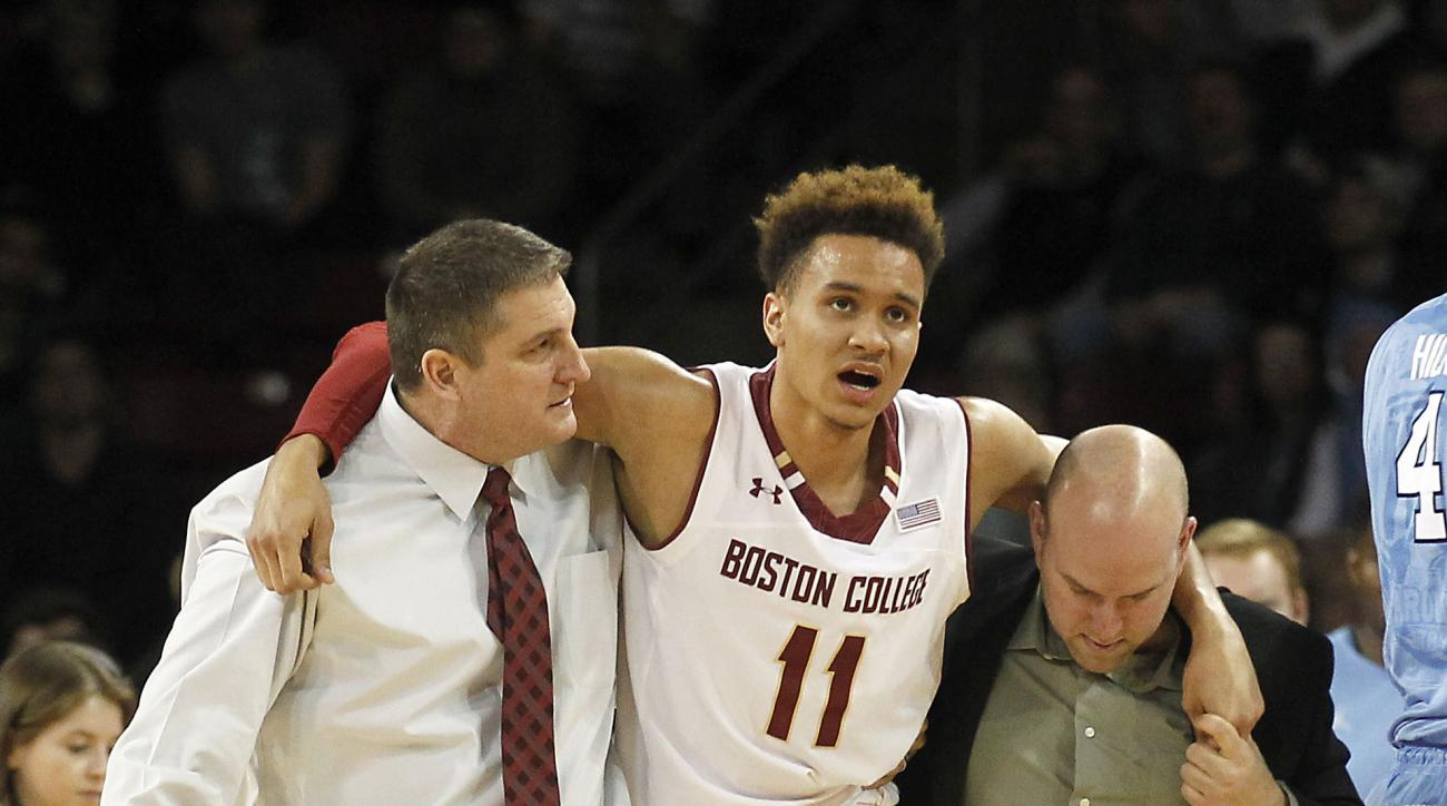 FILE - In this Feb. 9, 2016, file photo, Boston College head coach Jim Christian, left, helps  forward A.J.Turner (11) off the court after an injury during the second half of an NCAA college basketball game against North Carolina, in Boston. Should the Ea