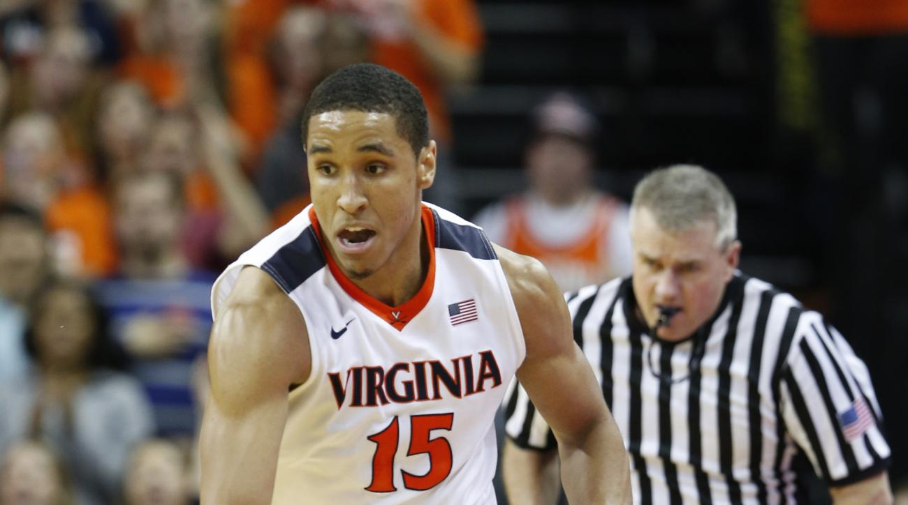 In this photo taken, Saturday Feb. 27, 2016, Virginia guard Malcolm Brogdon (15)  drives downcourt during the second half of an NCAA college basketball game against North Carolina in Charlottesville, Va. Brogdon has been at the heart of winning games, lea