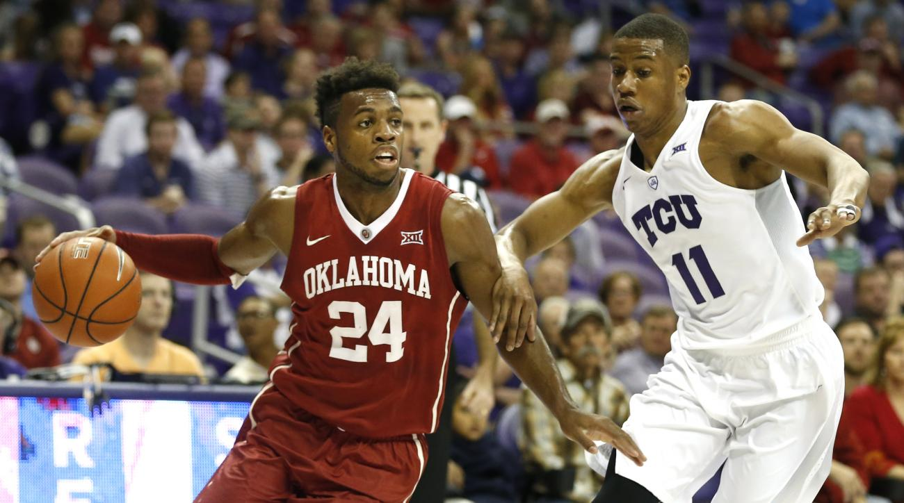 Oklahoma guard Buddy Hield (24) looks to pass as TCU guard Brandon Parrish (11) defends during the first half of an NCAA college basketball game, Saturday, March 5, 2016, in Fort Worth, Texas. (AP Photo/Ron Jenkins)