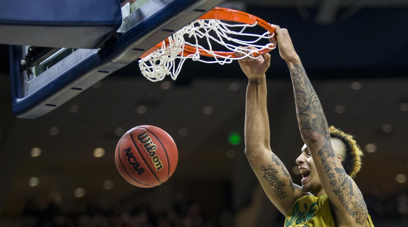 Notre Dame's Zach Auguste (30) dunks during the second half of Notre Dame's 89-75 win against North Carolina State in an NCAA college basketball game Saturday, March 5, 2016, in South Bend, Ind. (AP Photo/Robert Franklin)