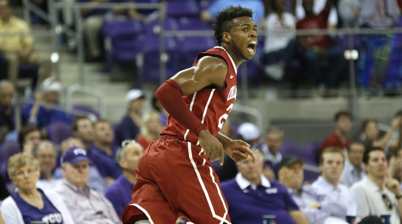 Oklahoma guard Buddy Hield reacts after scoring a basket as Oklahoma takes on TCU during the first half of an NCAA college basketball game, Saturday, March 5, 2016, in Fort Worth, Texas. Oklahoma won 75-67.(AP Photo/Ron Jenkins)