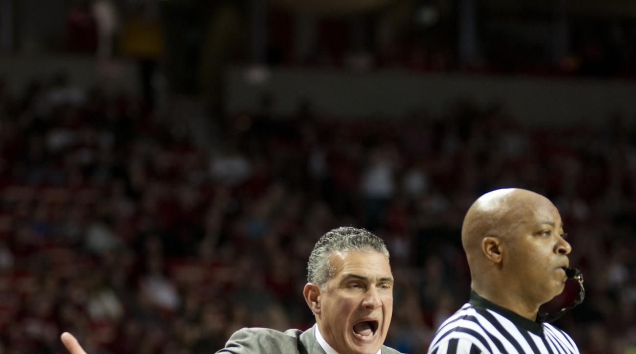 South Carolina head coach Frank Martin expresses displeasure of a call in the first half of an NCAA college basketball game against Arkansas in Fayetteville, Ark., Saturday, March 5, 2016. (AP Photo/Sarah Bentham)