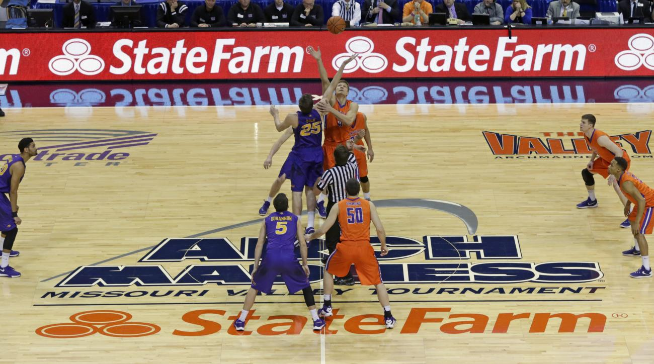 Northern Iowa's Bennett Koch (25) and Evansville's Egidijus Mockevicius (55) tip the ball to start an NCAA college basketball game in the championship of the Missouri Valley Conference men's tournament, Sunday, March 6, 2016, in St. Louis. (AP Photo/Tom G