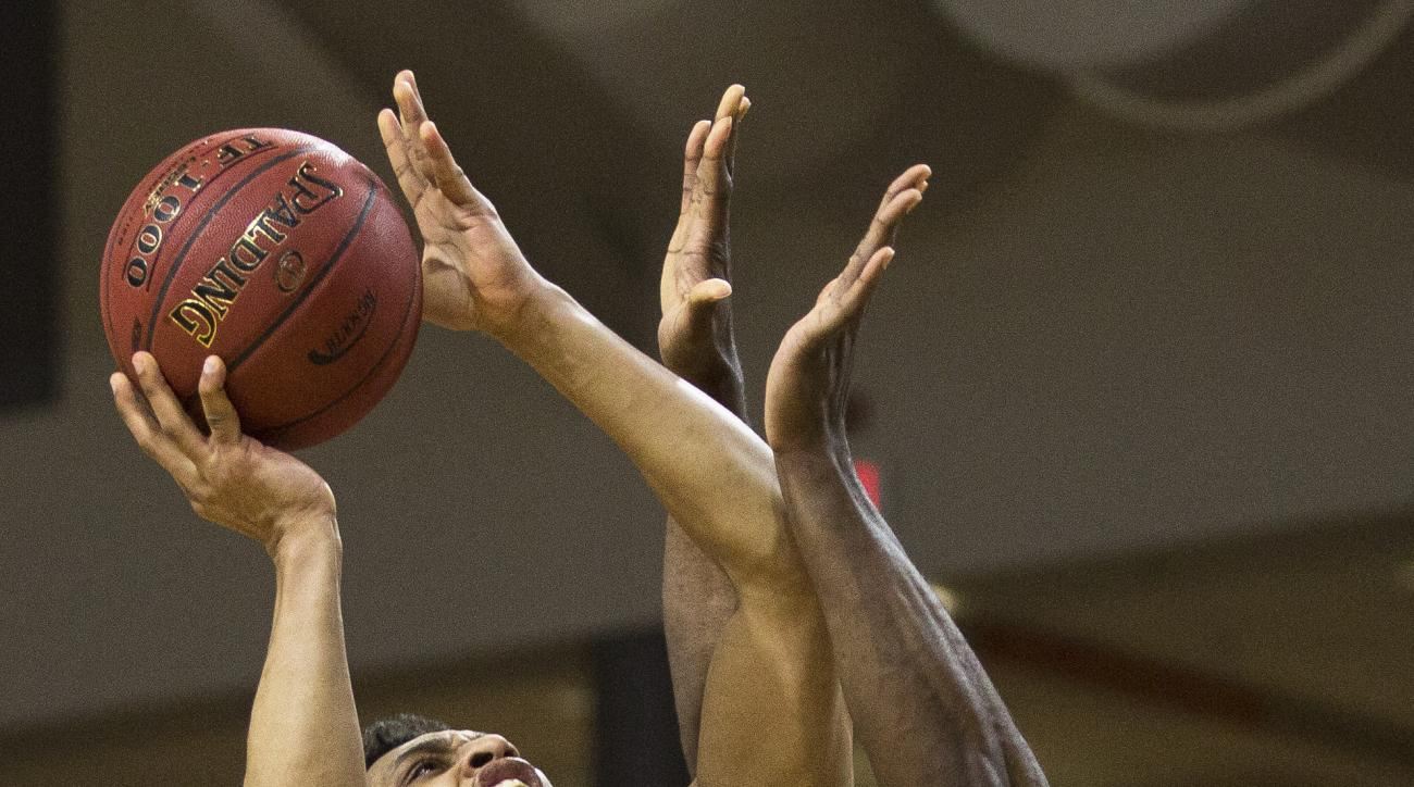 UNC Asheville's Will Weeks (32) attempts to shoot as Winthrop's Duby Okeke, right, defends during the first half of an NCAA college basketball championship game in the Big South Conference tournament in Buies Creek, N.C., Sunday, March 6, 2016. (AP Photo/