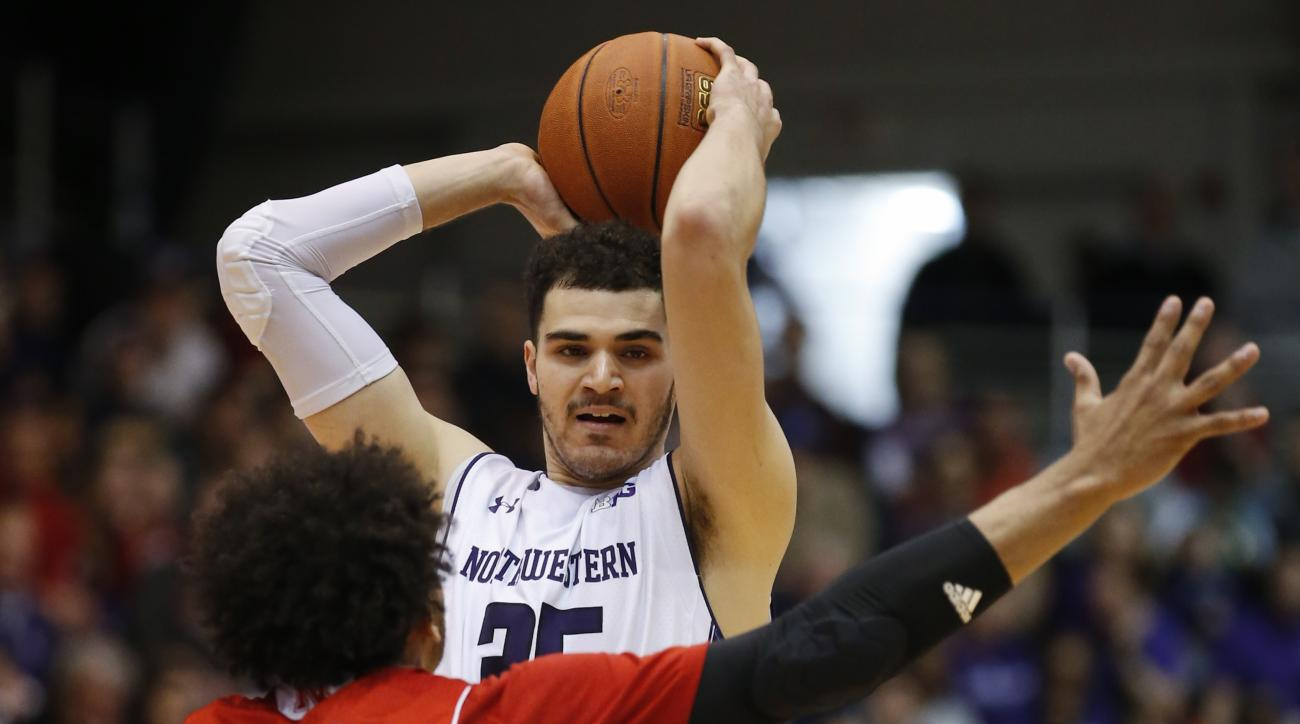 Northwestern forward Aaron Falzon (35) looks to pass the ball against Nebraska forward Shavon Shields (31) during the second half of an NCAA college basketball game Sunday, March 6, 2016, in Evanston, Ill. Northwestern won 65-54. (AP Photo/Kamil Krzaczyns