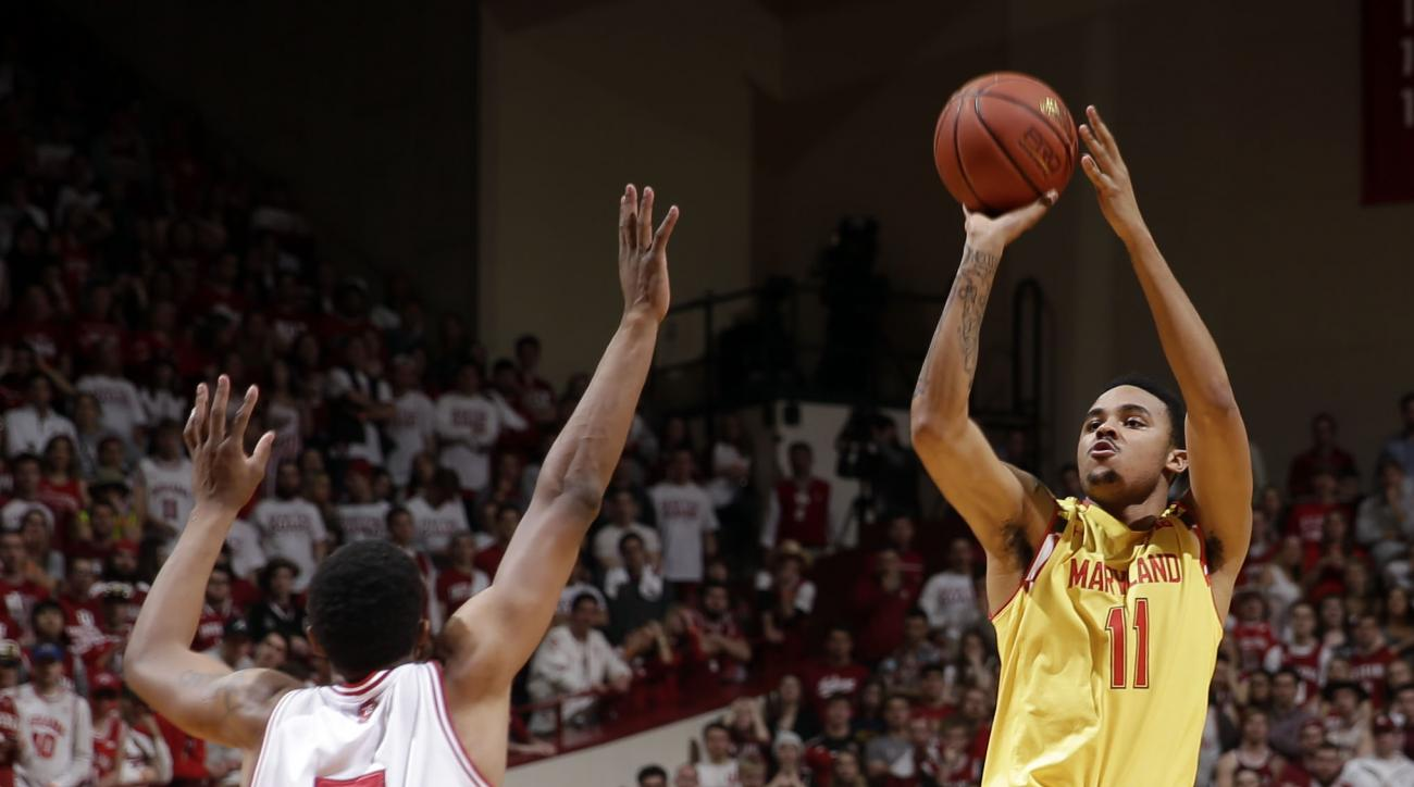 Maryland guard Jared Nickens (11) shoots over Indiana forward Troy Williams (5) in the first half of an NCAA college basketball game in Bloomington, Ind., Sunday, March 6, 2016. (AP Photo/AJ Mast)