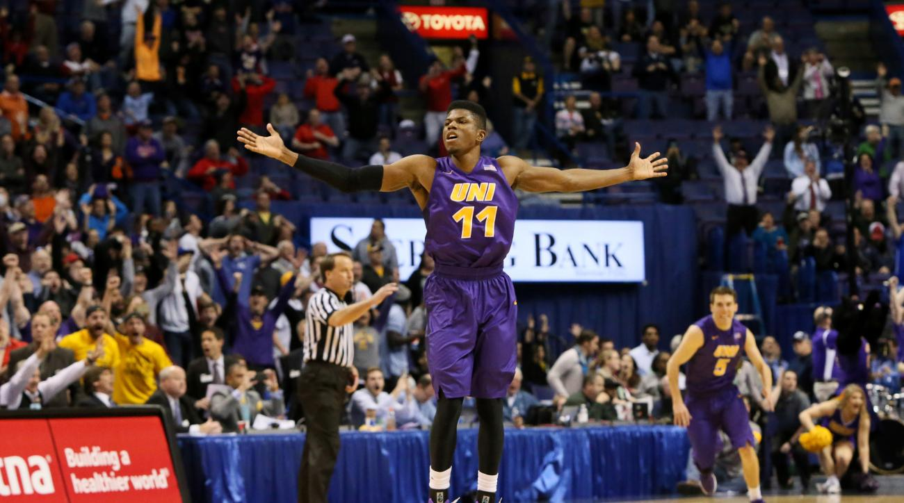 Northern Iowa guard Wes Washpun reacts after making the game-winning jump shot during an NCAA college basketball game against Evansville in the championship of the Missouri Valley Conference men's tournament in St. Louis on Sunday, March 6, 2016. (Chris L