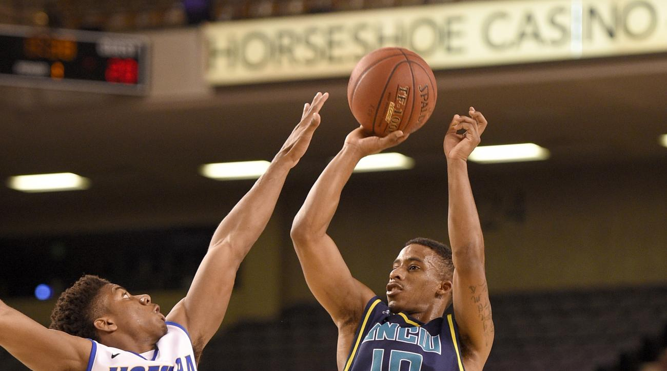 UNC Wilmington guard Denzel Ingram (10) takes a shot over Hofstra guard Justin Wright-Foreman (3) during the first half of an NCAA college basketball game in the Colonial Athletic Association championship, Monday, March 7, 2016, in Baltimore. (AP Photo/Ni