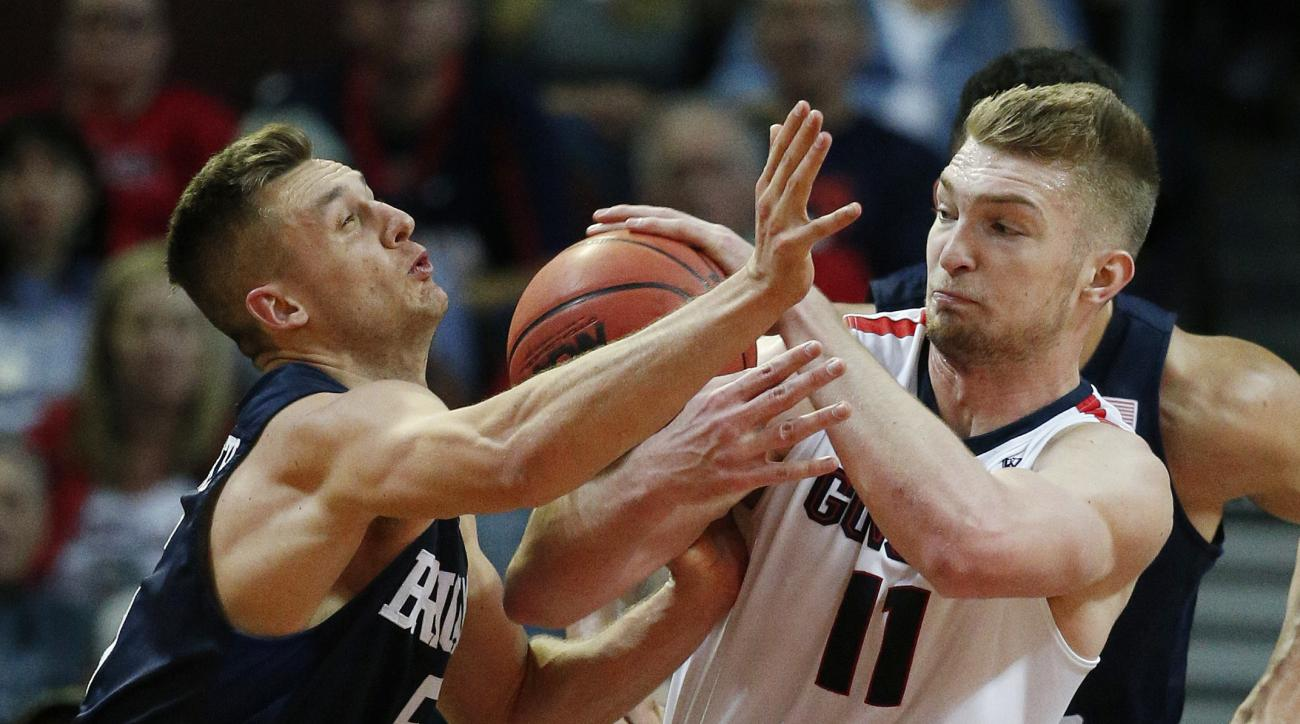 BYU guard Kyle Collinsworth, left, and Gonzaga forward Domantas Sabonis, right, battle for the ball during the second half of a West Coast Conference tournament NCAA college basketball game Monday, March 7, 2016, in Las Vegas. (AP Photo/John Locher)