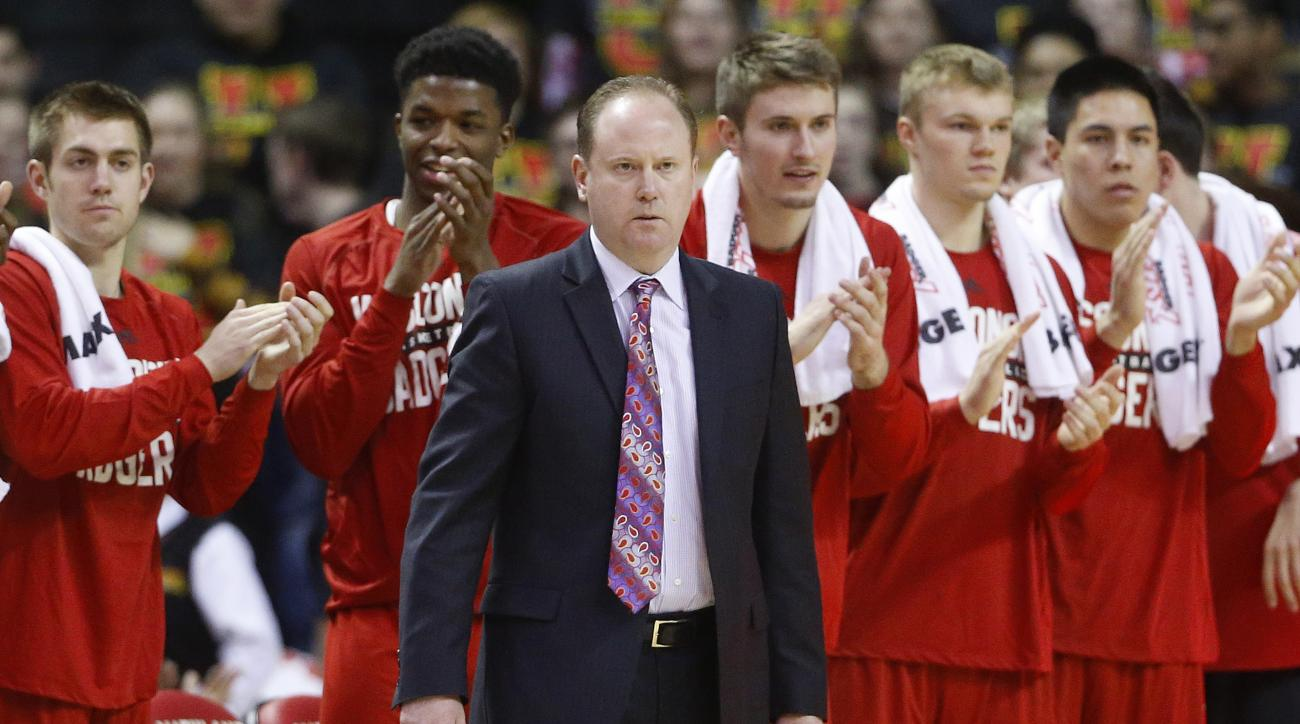 FILE - In this Feb. 13, 2016, file photo, Wisconsin coach Greg Gard watches the first half of the team's NCAA college basketball game against Maryland, in College Park, Md. Tuesday at Wisconsin is about first celebrating Greg Gard's first full day as the
