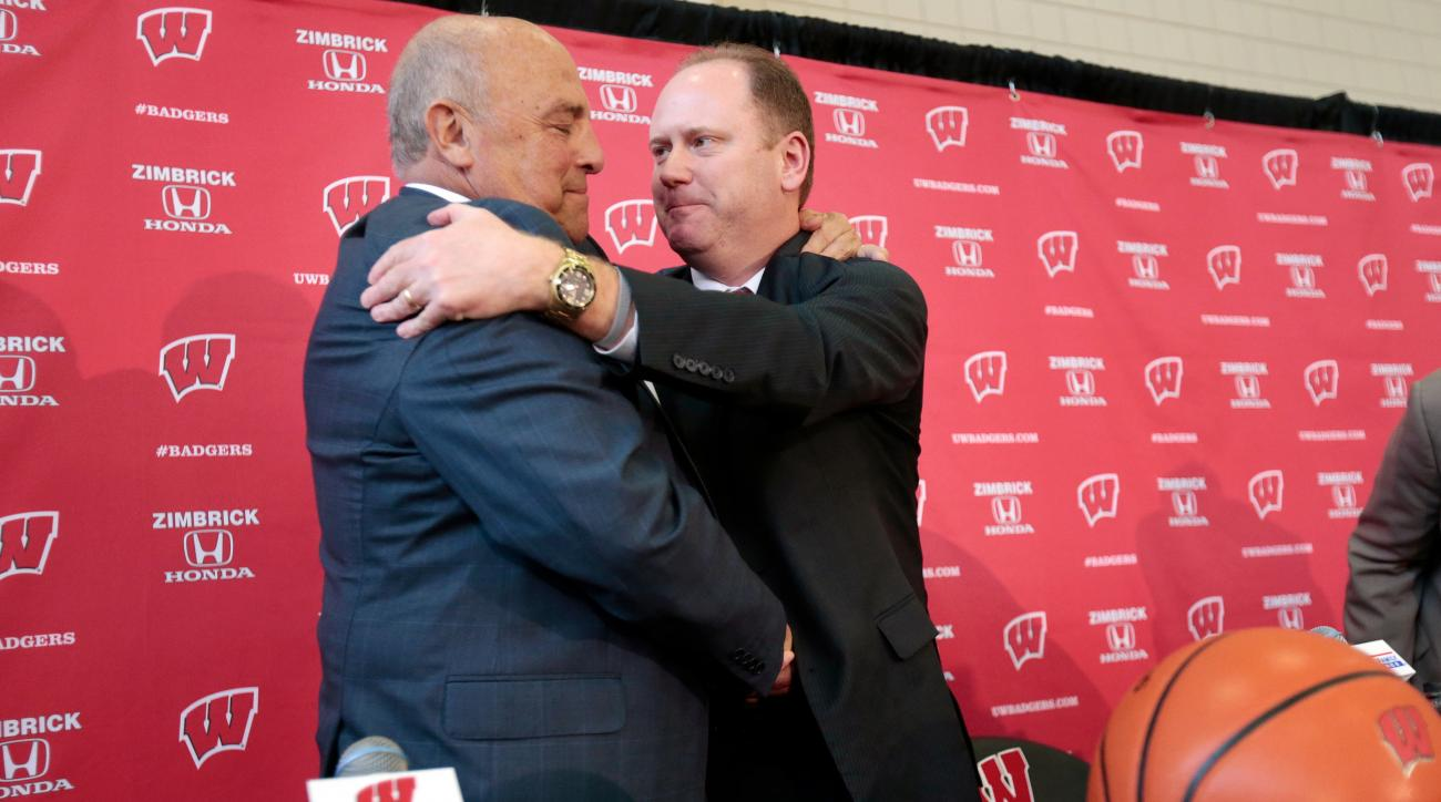 Wisconsin head coach Greg Gard, right, formerly interim head coach, right, embraces athletic director Barry Alvarez after an introductory NCAA college basketball press conference at the Nicholas Johnson Pavilion in Madison, Wis., Tuesday, March 8, 2016. (