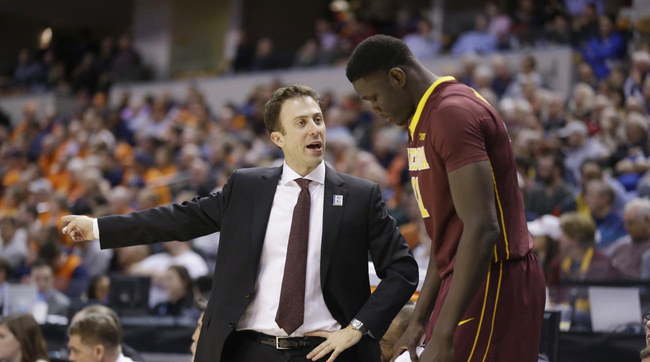 Minnesota's head coach Richard Pitino talks to Gaston Diedhiou (41) in the second half of an NCAA college basketball game against Illinois at the Big Ten Conference tournament, Wednesday, March 9, 2016, in Indianapolis. Illinois won 85-52. (AP Photo/Micha