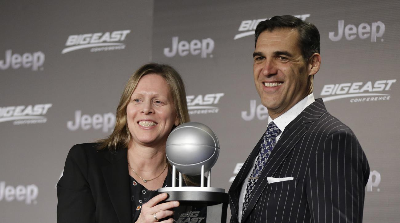 Villanova coach Jay Wright, right, poses for photos with Big East Conference Commissioner Val Ackerman after receiving the award as conference co-coach of the year, Wednesday, March 9, 2016, in New York. Wright shares the award with Seton Hall coach Kevin