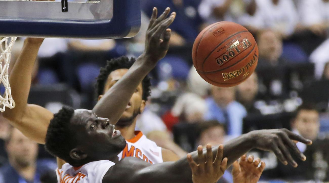 Georgia Tech forward Charles Mitchell, right, and Clemson center Sidy Djitte (50) vie for a rebound during the first half of an NCAA college basketball game in the Atlantic Coast Conference men's tournament in Washington on Wednesday, March 9, 2016. (AP P
