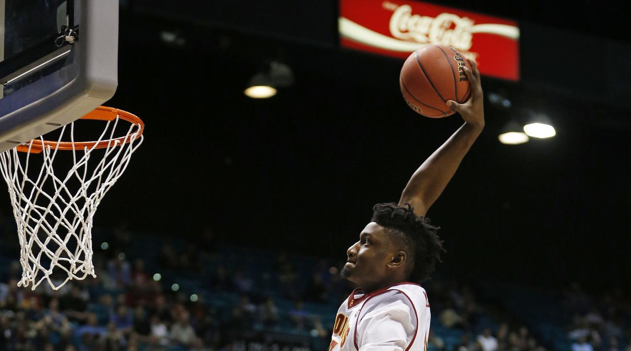 Southern California forward Chimezie Metu dunks against UCLA during the first half of an NCAA college basketball game in the first round of the Pac-12 men's tournament Wednesday, March 9, 2016, in Las Vegas. (AP Photo/John Locher)