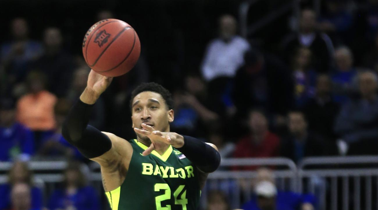 Baylor guard Ishmail Wainright (24) saves the ball during the first half of an NCAA college basketball game against Texas in the quarterfinals of the Big 12 conference tournament in Kansas City, Mo., Thursday, March 10, 2016. (AP Photo/Orlin Wagner)