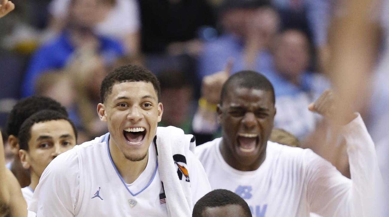 The North Carolina bench cheers a play during the second half of an NCAA college basketball game in the Atlantic Coast Conference tournament, in Washington , Thursday, March 10, 2016. North Carolina defeated Pittsburgh 88-71. (AP Photo/Steve Helber)