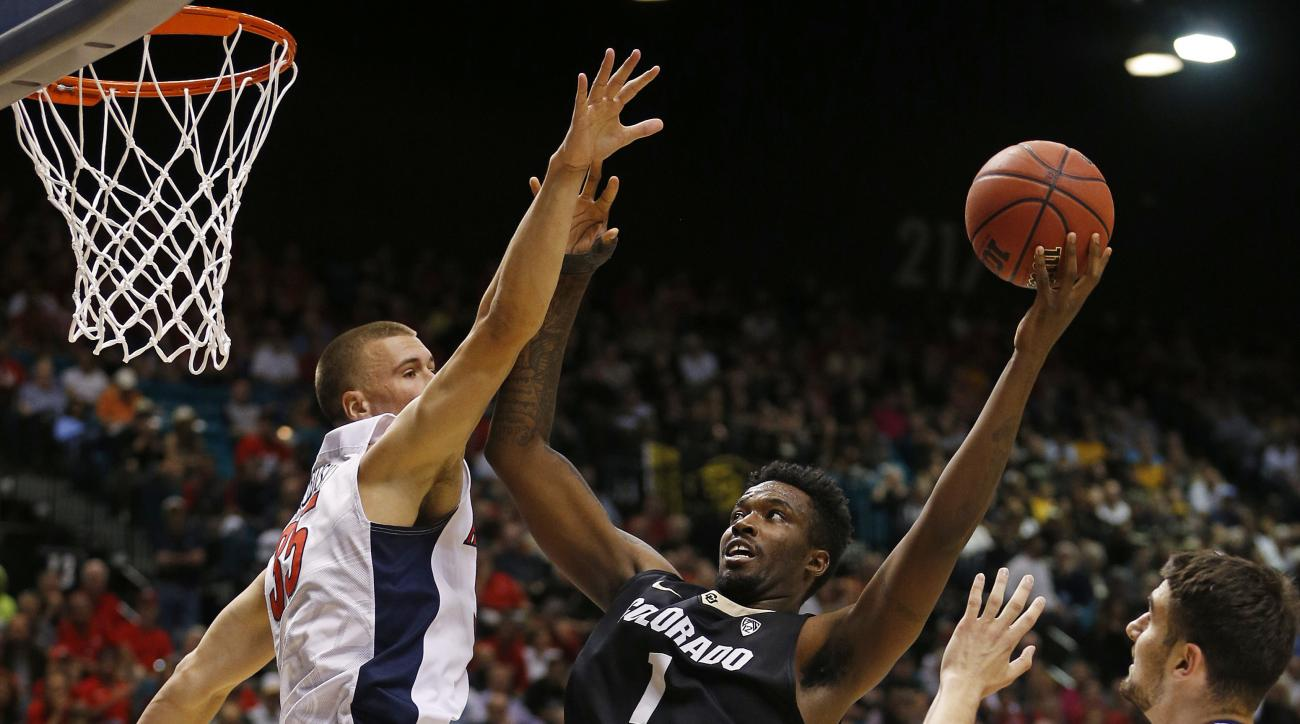 Colorado forward Wesley Gordon (1) shoots around Arizona center Kaleb Tarczewski, left, during the first half of an NCAA college basketball game in the quarterfinal round of the Pac-12 men's tournament Thursday, March 10, 2016, in Las Vegas. (AP Photo/Joh
