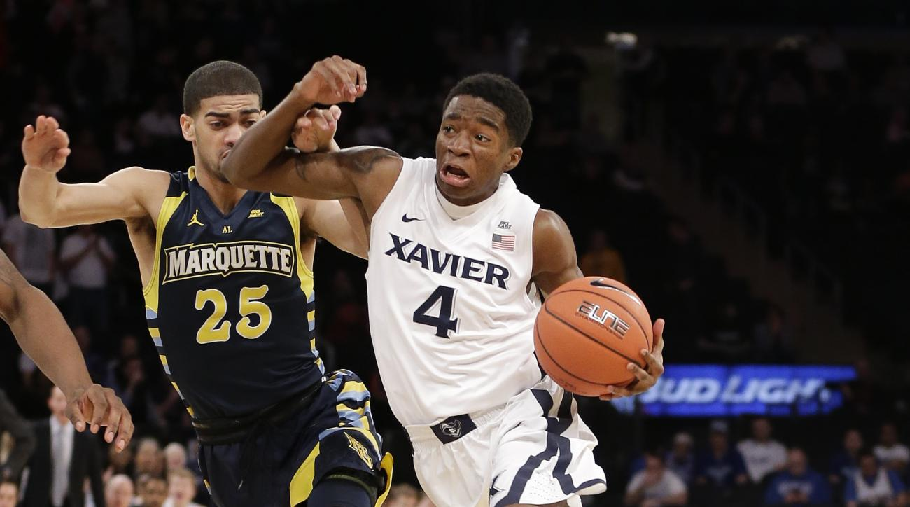 Xavier guard Edmond Sumner (4) drives to the basket against Marquette guard Haanif Cheatham (25) during the first half of an NCAA college basketball game during the Big East men's tournament, Thursday, March 10, 2016, in New York. (AP Photo/Julie Jacobson