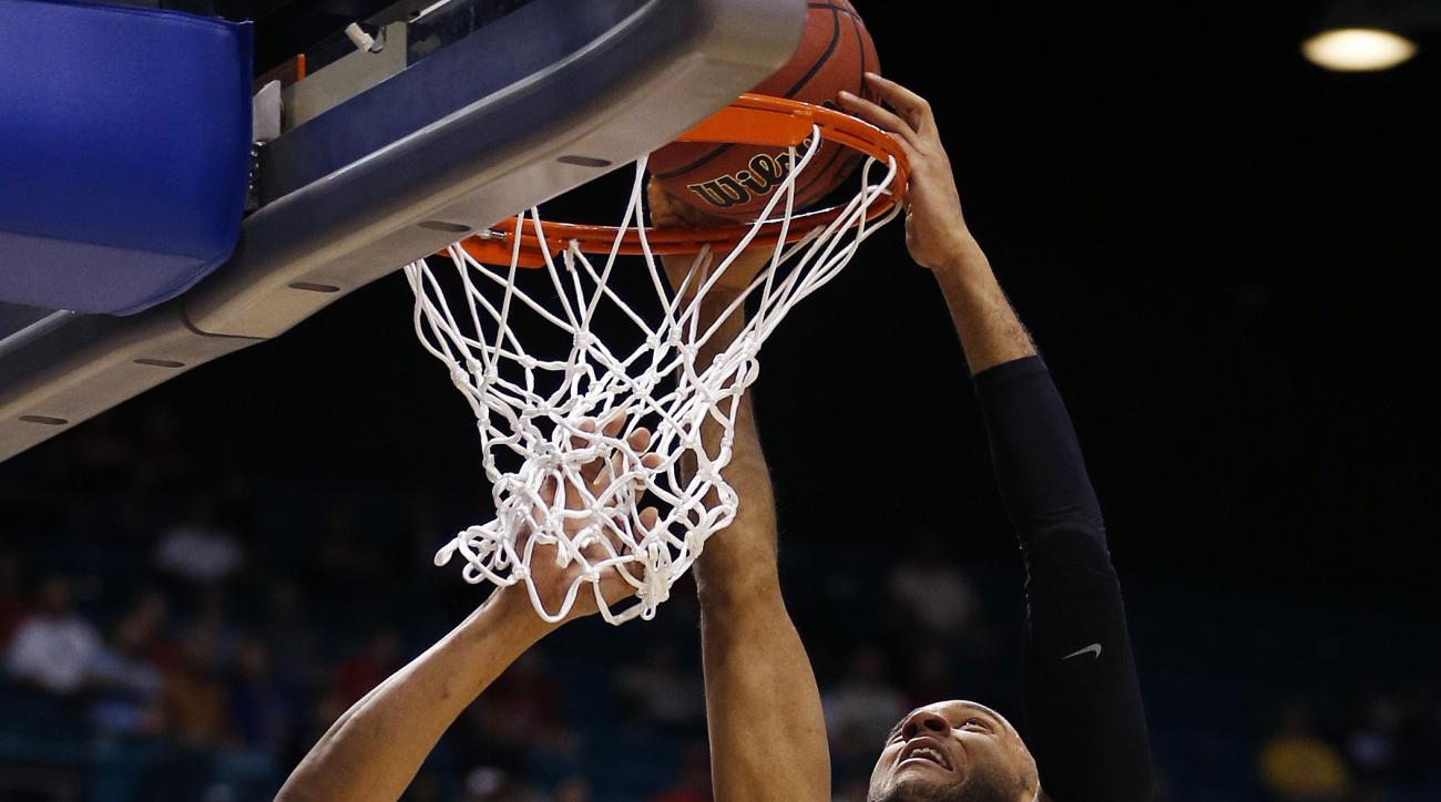 Southern California guard Julian Jacobs dunks over Utah guard Lorenzo Bonam during the first half of an NCAA college basketball game in the quarterfinal round of the Pac-12 men's tournament Thursday, March 10, 2016, in Las Vegas. (AP Photo/John Locher)