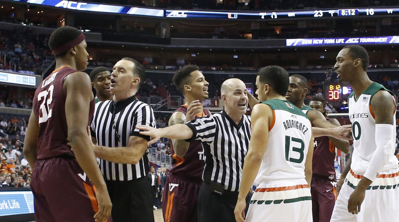 Virginia Tech forward Zach LeDay (32) and Miami guard Angel Rodriguez (13) are separated by the officials during the first half of an NCAA college basketball game in the Atlantic Coast Conference men's tournament, Thursday, March 10, 2016, in Washington.