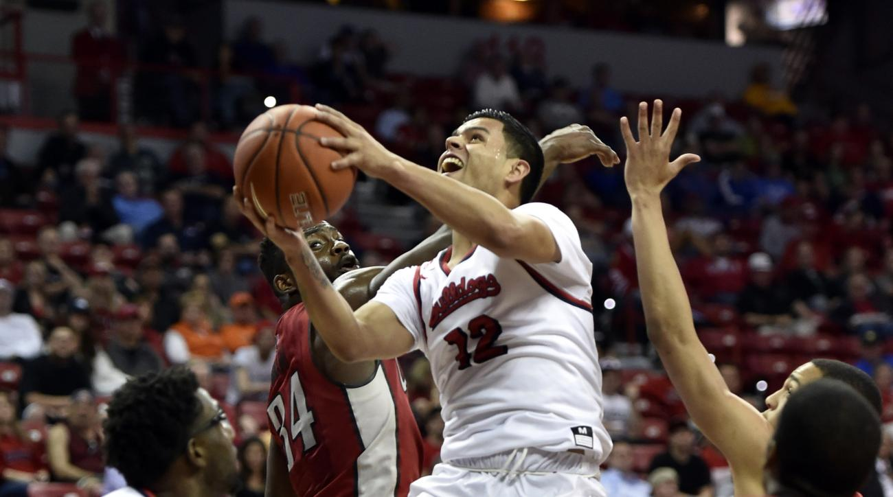 Fresno State's Cezar Guerrero (12) shoots against UNLV during the second half of an NCAA college basketball game at the Mountain West Conference men's tournament Thursday, March 10, 2016, in Las Vegas. (AP Photo/David Becker)