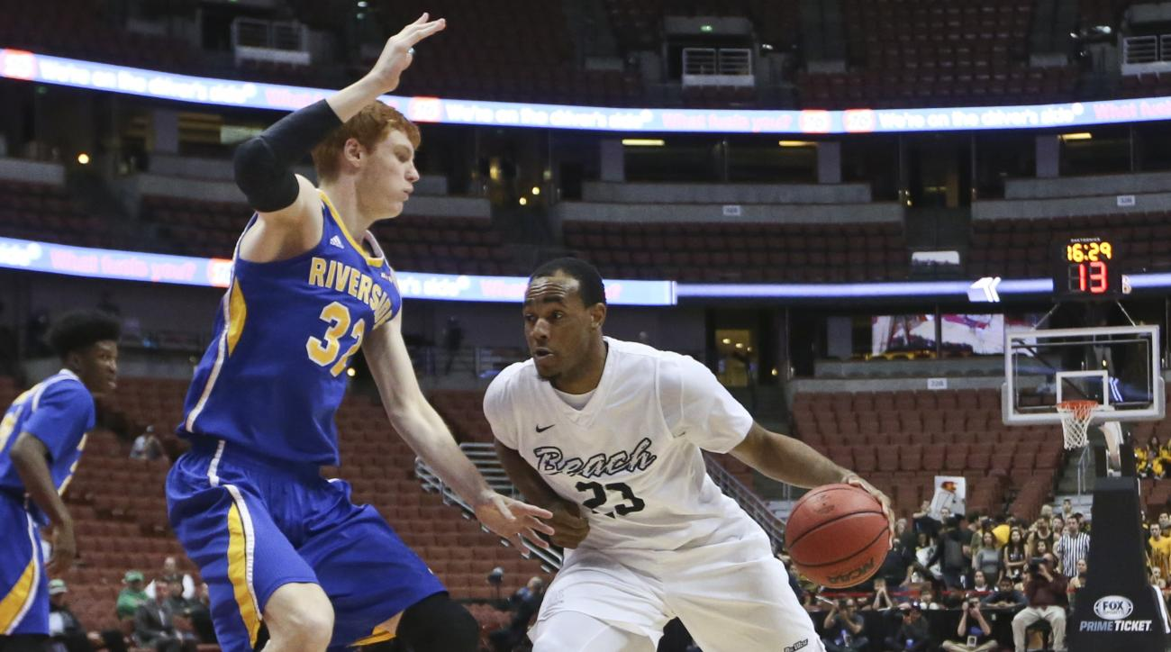 Long Beach State forward Roschon Prince drives around UC Riverside center Menno Dijkstra during the second half of an NCAA college basketball game at the Big West conference tournament Thursday, March 10, 2016, in Anaheim, Calif. (AP Photo/Lenny Ignelzi)