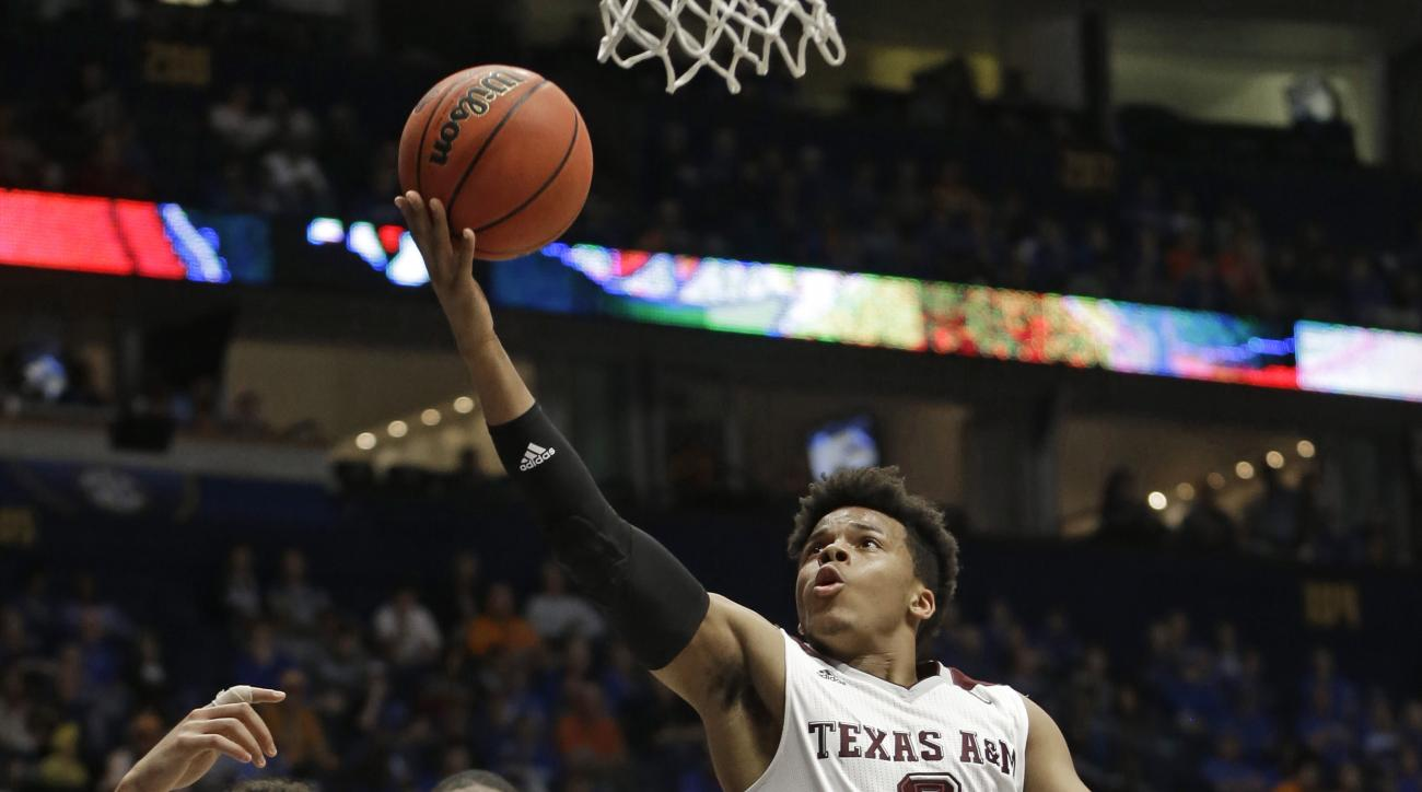 Texas A&M's Admon Gilder (3) drives to the basket against Florida during the second half of an NCAA college basketball game in the Southeastern Conference tournament in Nashville, Tenn., Friday, March 11, 2016. (AP Photo/Mark Humphrey)