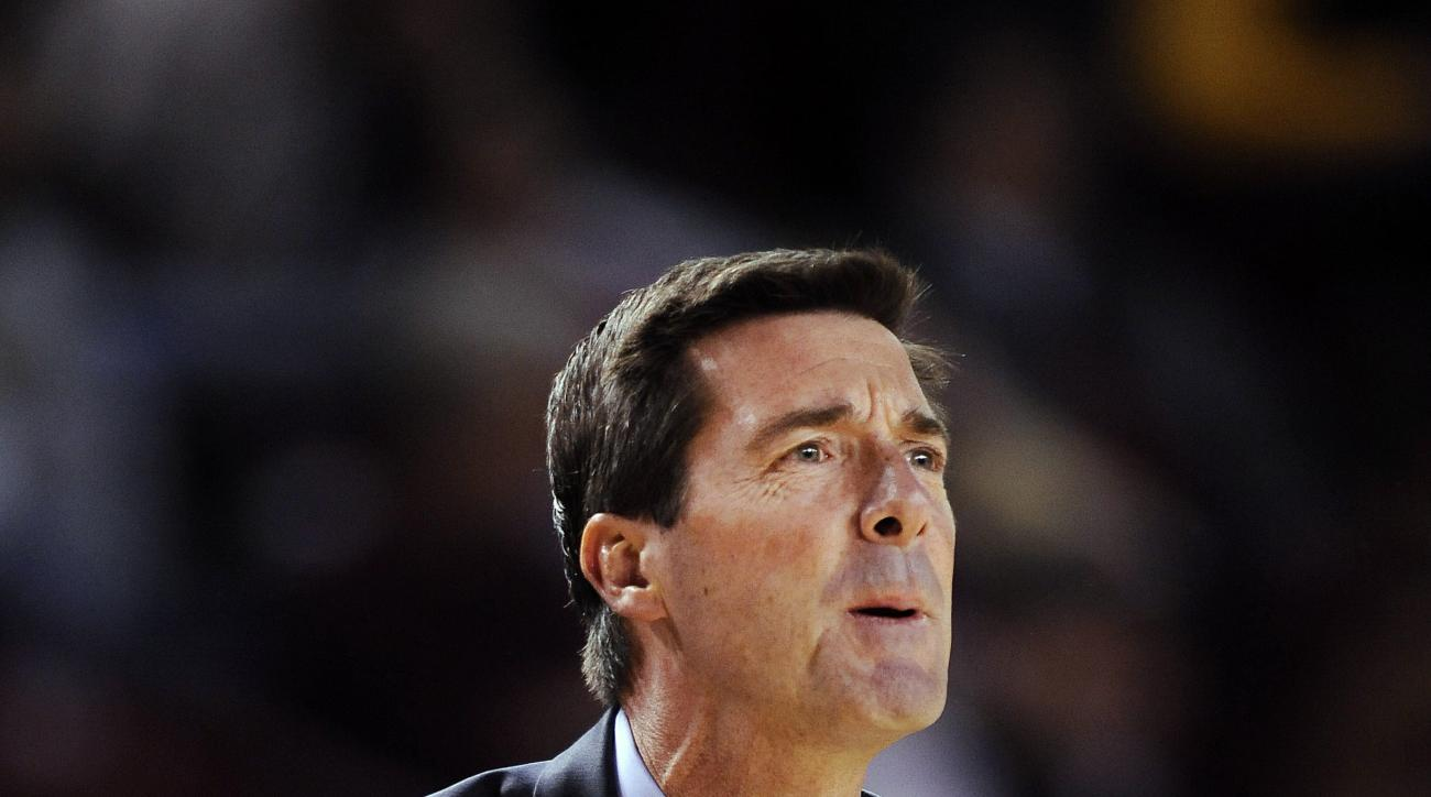 FILE - This is a Dec. 15, 2013, file photo showing Denver head coach Joe Scott reacting on the sideline during the first half of an NCAA college basketball game against the Wyoming, in Denver. The University of Denver has fired Joe Scott after a nine-year