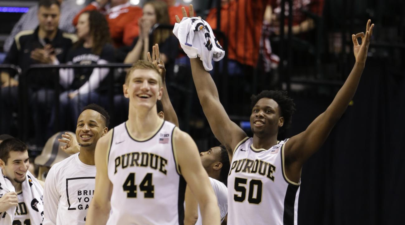 Purdue's Isaac Haas (44) and Caleb Swanigan (50) celebrates a three point basket from the bench during the second half of an NCAA college basketball game against the Illinois in the quarterfinals at the Big Ten Conference tournament, Friday, March 11, 201