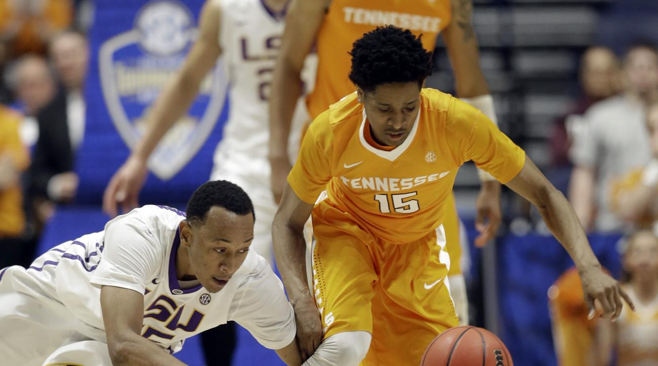Tennessee's Detrick Mostella (15) and LSU's Tim Quarterman (55) chase a loose ball during the second half of an NCAA college basketball game in the Southeastern Conference tournament in Nashville, Tenn., Friday, March 11, 2016. (AP Photo/Mark Humphrey)